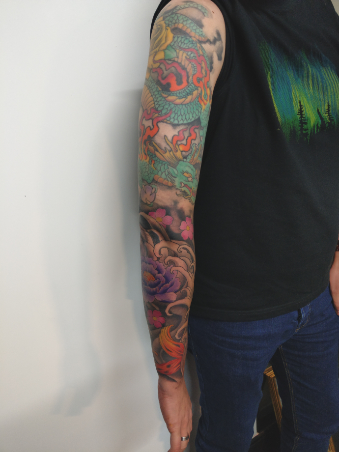 colourful peonie and dragon tattoo sleeve