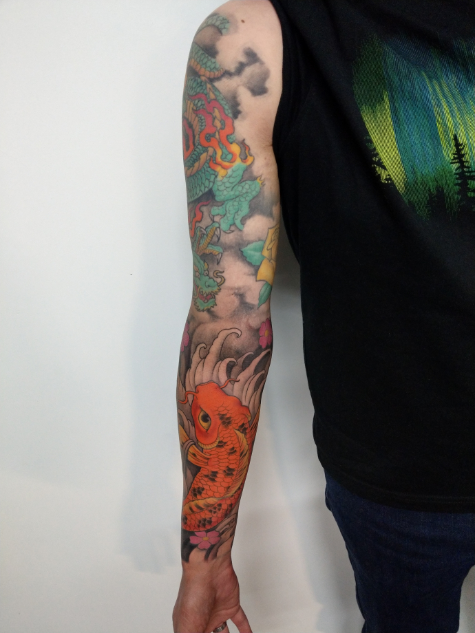 colourful dragon and koi tattoo sleeve