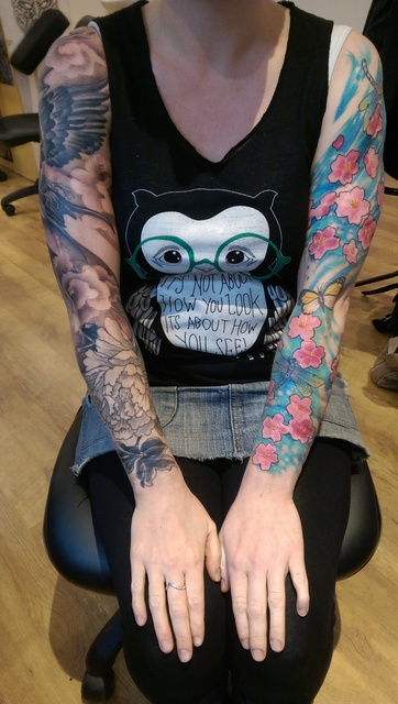 lady with two full sleeve tattoos scar cover ups frontal view