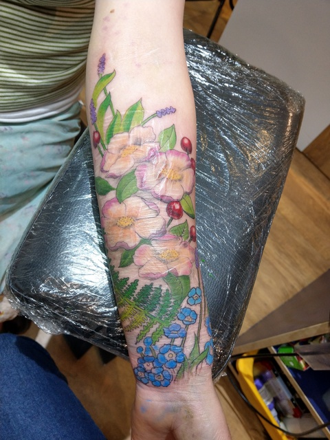 work in progress flower tattoo covering up scars
