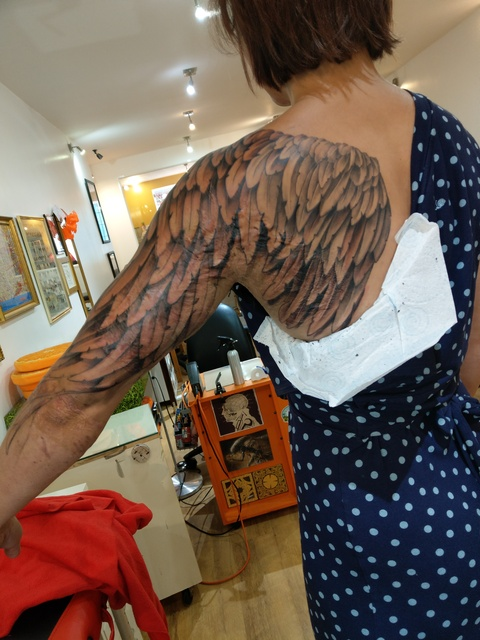tattooed wing scar cover up black and grey